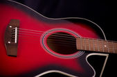 Beautiful red guitar — Stock fotografie