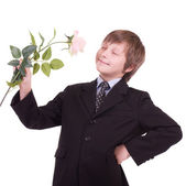 Little beautiful boy with rose — Stock Photo