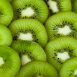 Stock Photo: Healthy food background with beautiful green kiwi