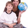 Little schoolboy with mother and globe — Stock Photo