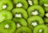 Healthy food background with beautiful green kiwi — Stock Photo
