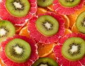 Background with kiwi, grapefruit and orange — Stock Photo