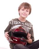 Little beautiful boy with motorcycle helmet — Stock Photo