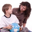 Little schoolboy and mother with globe — Stock Photo