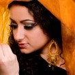 Beautiful arabian woman in color yashmak — Stock Photo