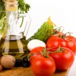 Olive oil and tomatoes and other vegetables — 图库照片