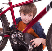 Little beautiful boy with bycicle — Stock Photo