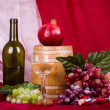 Composition with wine, grape, pomegranate and barrel — Stock Photo