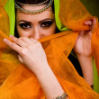 Beautiful young woman in color arabian clothes — Stock Photo #9270091