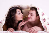 Beautiful pair of lovers in bed — Stock Photo