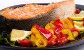 Fried salmon with grilled vegetable and lemon — Stock Photo