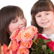 Stock Photo: Mother with daughter with pink roses