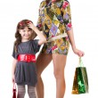 Happy mother and little girl with shopping bags - Foto de Stock  