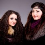The beautiful girls in a fur coat — Stock Photo #9300648