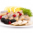Stock Photo: Testy cut herring with vegetable on plate