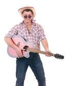 Güzel adam kovboy şapkası ve gitar — Stok fotoğraf
