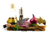 Olive oil, knife, spice and vegetables — Stock Photo