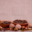 Nuts, raisin, cinnamon, tea and coffee — Stock Photo