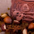 Royalty-Free Stock Photo: Tasty nuts and clay pot