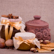 Royalty-Free Stock Photo: Tasty jam, cupcakes, clay pot and nuts