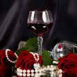 Stock Photo: Red vine glass with red roses on black background