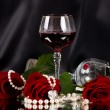 Red vine glass with red roses on black background - Stock Photo