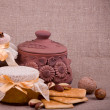 Tasty jam, cupcakes, clay pot and nuts — Stockfoto