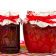 Stock Photo: Jar with jam (cherry, strawberry)