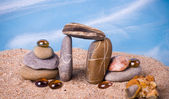 Beautiful exotic crystals and stones on sand — Stock Photo