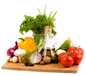 Olive oil and vegetables on a white background — Stock Photo