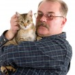 Old man with his cat on white background — Stok fotoğraf