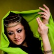 Stock Photo: Beautiful young woman in color arabian clothes