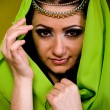 Beautiful young woman in color arabian clothes - Stock Photo