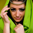 Stock Photo: Beautiful young womin color arabiclothes