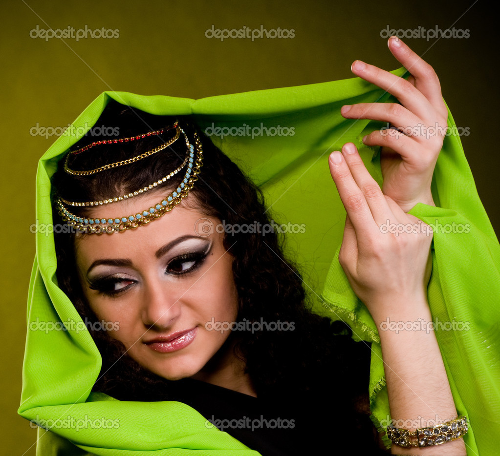 Beautiful young woman in color arabian clothes  Stock Photo #9648818