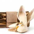 Sexy fashionable shoes with handbag and golden jewelry on white background. — Stock Photo #9703853