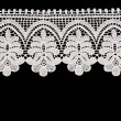 White floral lace on a black background. — Stock Photo #9703925