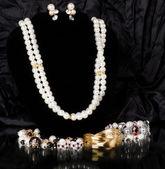 Beautiful jewelry on black background — Stock Photo