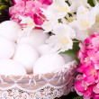 Basket with Easter eggs and spring flowers — Stockfoto