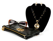Fashionable handbag and golden jewelry, glasses on white background. — Stock Photo