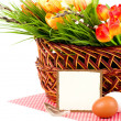 Basket with Easter eggs and spring flowers — Stock Photo