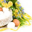 Basket with Easter eggs and spring flowers - Stock Photo