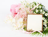 Gold wedding rings on a bouquet of white roses with banner add — Stock Photo