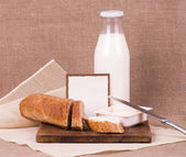Bread and milk for breakfast — Stock Photo