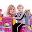 Mother and baby boy with child's furniture — Stock Photo #9986477