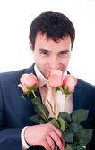 Homme de saint-valentin avec fleurs sur fond blanc — Photo