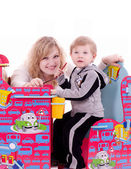Mother and baby boy with child's furniture — Stock Photo