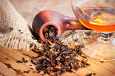 Cognac and tobacco pipe — Stock Photo