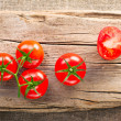 Fresh tomatoes on vintage wooden cutting board - Stock Photo