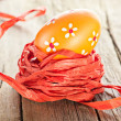 Easter painted egg and ribbon decor - Stock Photo